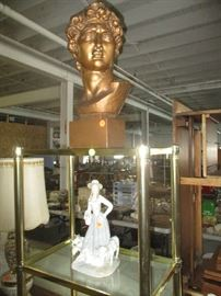 Lladro figurine, bust and brass and glass shelf unit
