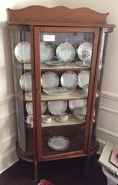 oak china cabinet it holds lots of fine china ( china not for sale )