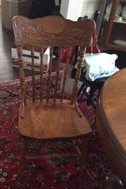 pair pressed back oak chairs