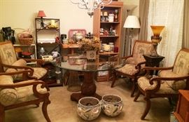 Wooden glass-topped table with 4 upholstered arm chairs, shelves, small kitchen appliances, lamps, & more