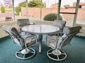Round Glass-top Patio Table w/ 4 Swivel Rocking Chairs