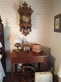 Vintage oak wall clock, vintage Shaker style single drawer cherry side table.