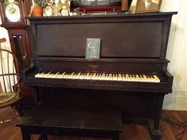 "Vintage Wellington mahogany upright piano.        Includes the bench. We are so very generous!                 The serial number on this piano (244621) dates it at 95 years old, manufactured between 1923-1924. The soundboard states ""The Cable Company, Chicago""."
