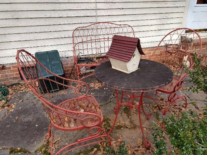 Fun, vintage wrought iron outdoor set.
