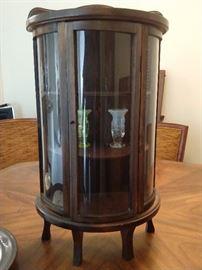 Salesman's sample curved glass curio cabinet.