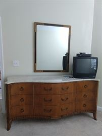 Here's the swoopy, marble-topped French dresser.
