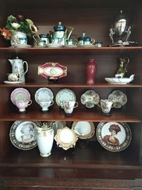 Typical little old lady china collection, with teacups/saucers, hand painted Limoges porcelains, German lusterware chocolate set.