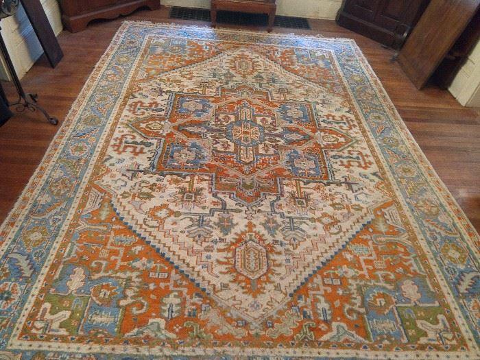 """1960's hand woven Persian Heriz rug, measures 8' 3"""" x 10' 2""""."""