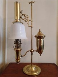 Better view of the antique brass/milk glass Aladdin oil lamp - very heavy! Antique American Aladdin brass oil lamp with milk glass shade, circa 1915. This student oil lamp made by Aladdin is in brass with the original milk glass shade; dimensions 34″ T x 15.5″ W