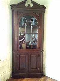 One of the mahogany corner cabinets. This one filled with china and crystal stemware.