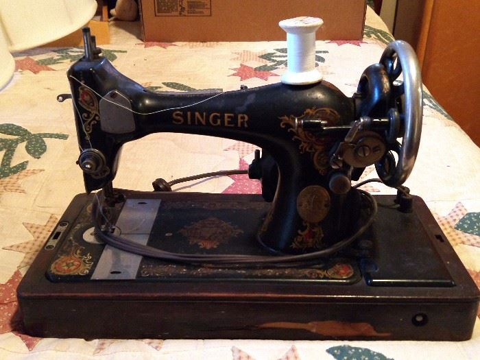 Vintage Singer sewing machine, motor number 4258082, with wooden carrying case; Simanco, USA.
