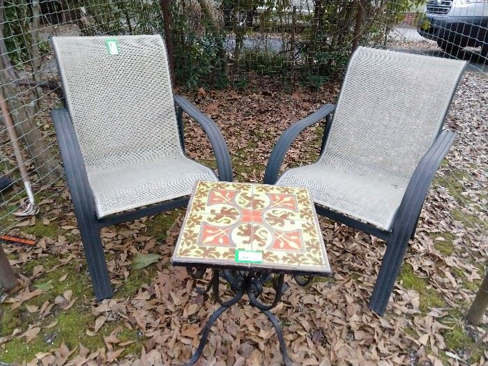 Great little tile-topped table, with curlicued cast iron base, flanked by a couple of all-weather outdoor armchairs.                                                                                                   All you need is some microbrew beer, a Longaberger basket full of pretzels and a cozy fire to while away the winter days.