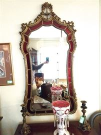 LOVE this fancy-schmancy gilt wood framed mirror, surrounded with crimson glass. Bohemian milk & ruby glass lustre lamp and a pair of vintage brass & porcelain candleholders.