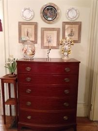 Wonderful 1940's mahogany 5-drawer chest in pristine condition; manufactured by Biggs Furniture Co., Richmond, VA.                                                                                      The three matted and framed pics are vintage regional German dress, worn by Deutsche Divas, strutting the Rhine runway.