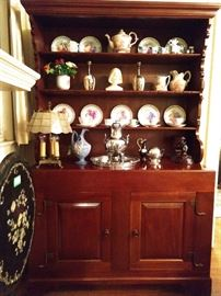 Vintage cherry hutch. It even has slots for your sterling spoon collection. Those crafty Amish, they think of everything!