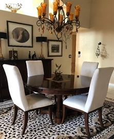 """Stanley Dining Room: 60"""" Round Pedestal Table (perimeter extensions add 18"""" to overall width) w 6 Off-White Microfiber Chairs, Buffet w Black Granite Top, Sleek Table Lamps w Black and Brass Shades"""