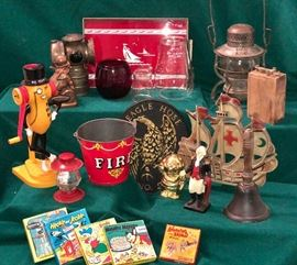 Old lanterns and globes, doorstops, fire collectibles and early cartoon films.