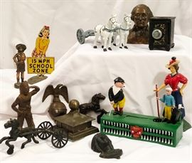 Cast iron banks and toys.  Collectible metal figurines and doorstops.