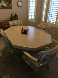 Kitchen table with leaf and 4 chairs on coasters