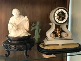 FIGURES AND SWINGING CLOCK