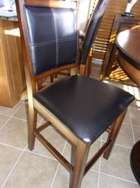 1 year old Round pub height table and unique pedestal with four pub height chairs and buffet