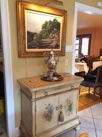 Hand painted chest with drawers and storage behind the 2 doors , silver coffee urn    art