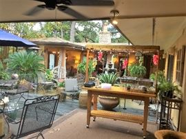 lots of outside patio furniture , flower pots, wooden bar / serving  cart great for outside cook outs, yard art, tables, chairs, lounge chaise , sofa  and other outside   items.  Must see to appreciate this great area for entertainment