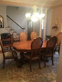 Hibriten Dining room table with 4 regular chairs and  two captain's chairs.  Also has two large table inserts and protective table covers.