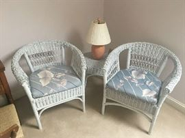 Two matching wicker chairs, table and lamp.