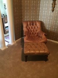 Very comfortable leather tufted chair with ottoman.   The leather on the ottoman is a bit different than the chair.