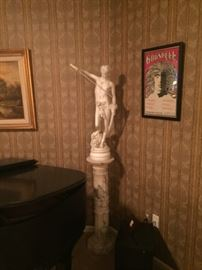 Marble column with resin statue of David and Goliath
