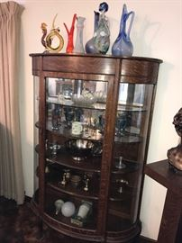 Oak curved glass china cabinet.