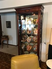 Howard Miller lighted display cabinet with Collector plates