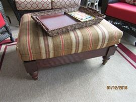 RED, TAN AND BROWN OTTOMAN