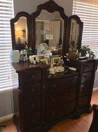 6 pc master bedroom set including King Bed, dresser with mirror, vanity with mirror, pair of night stands and armoire. Sold as set only. Mattresses not included. Items on vanity not for sale.