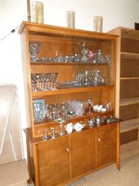 mid century walnut china cabinet, filled with cut & pressed glass, we have a few pieces of sterling & some costume jewelry