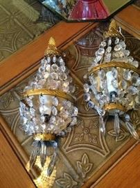 Gold and crystal sconces
