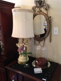 Vintage lamp; oval mirror; domed bell jar display with wooden base