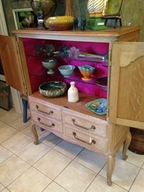 French Country armoire/cabinet has shelf and drawer storage.