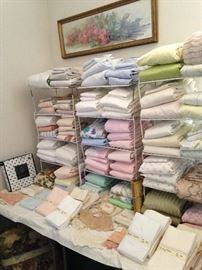 Many towels, sheets, and pillow cases