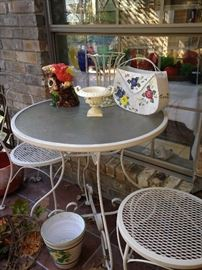White patio table with 2 chairs