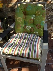 One of two matching patio chairs