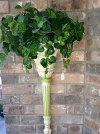 Wall sconce with greenery