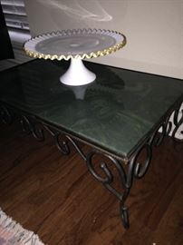 Low table with marble top; white (trimmed in gold) cake plate