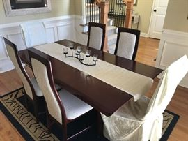 Dining room table and chairs. Rug also for sale.