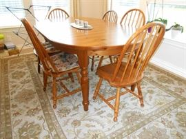 Beautiful high end rug and exquisite wooden breakfast set!
