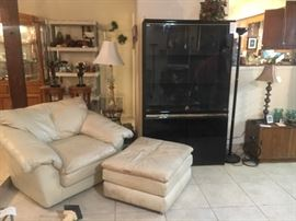 Matching cushy leather chair, contemporary black cabinet/armoire, lamp
