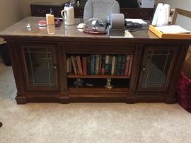 "BUY IT NOW!  Lot #101 - Beautiful Executive Desk.  Two cabinets in front with leaded glass doors & glass shelves.  Desk has a thick glass top to protect the herringbone pattern design.  It has seven felt-lined drawers.  Dimensions 70"" x 34"" x 30"" (high) - $750"