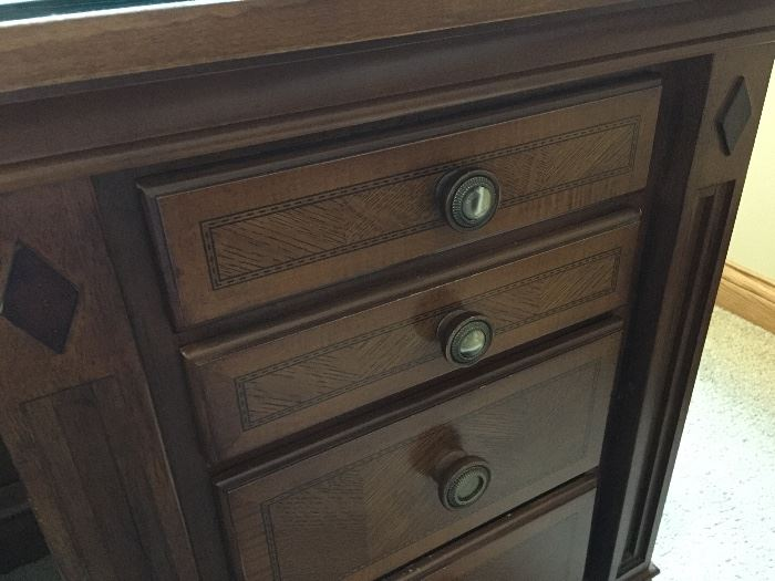 BUY IT NOW!  Lot #101 - Beautiful Executive Desk.  Two cabinets in front with leaded glass doors & glass shelves.  Desk has a thick glass top to protect the herringbone pattern design.  It has seven felt-lined drawers.  $750