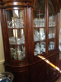 Beautiful china cabinet loaded with china and stemware